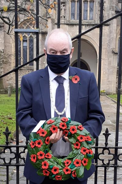 Wreath of woollen poppies laid at St. John's Church, Glastonbury by Cllr Nick Cottle, Deputy Chair of Mendip District Council.
