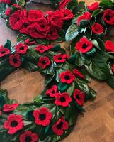 An image relating to Woollen poppy eco-wreaths will mark Remembrance Sunday across Mendip